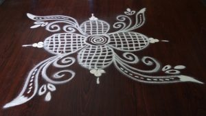 Simple rangoli with chalk and white flour